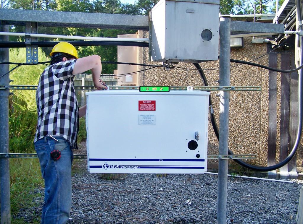 LBA field engineer Adam Carlson checks ATU TTM-1 installation