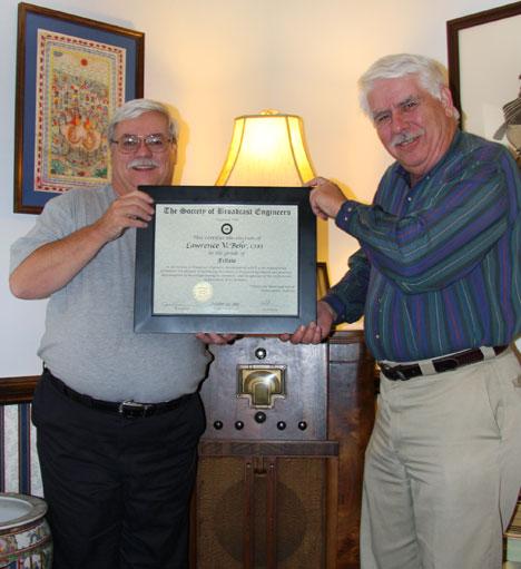 Michael Hayden presents SBE Fellow honor to Lawrence Behr