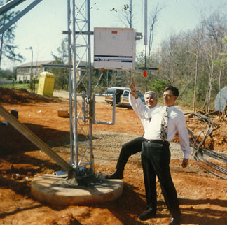 CEO Behr & then president Win Donat review a 1990's cell tower detuning system