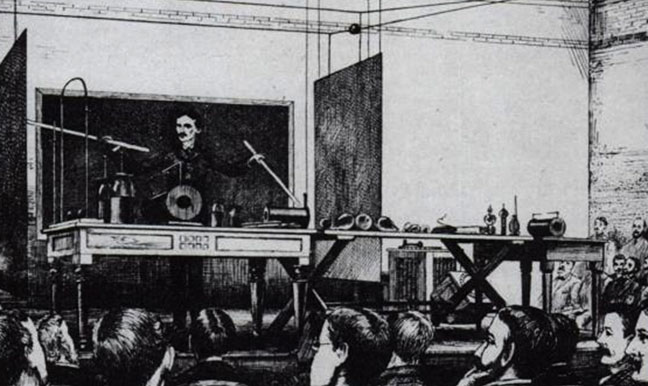Tesla demonstrating WPT in an 1891 lecture at Columbia College, New York.